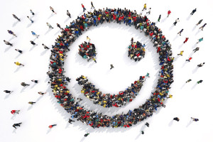 3D Rendering smiley face formed by groups of people